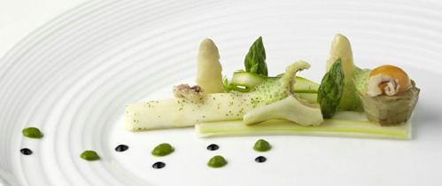 A picture shows artichoke with asparagus salad