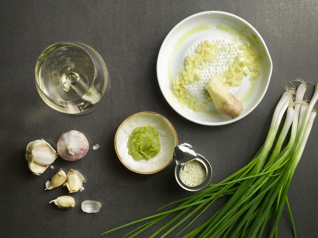 ginger, spring onion, wasabi and garlic on grey background.