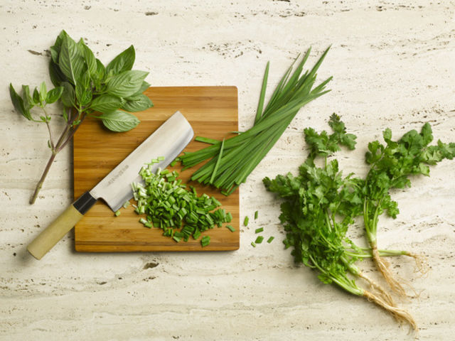 Fresh Herbs on wooden board.