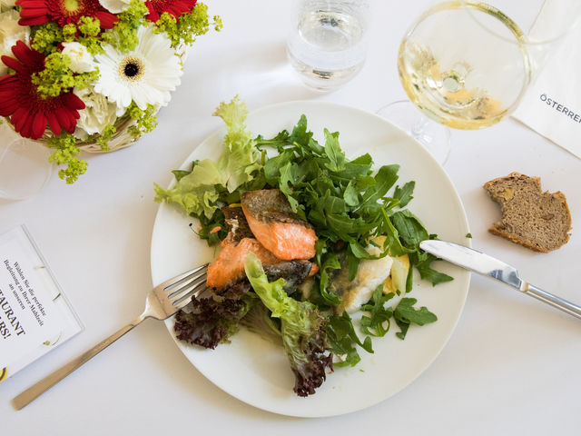 A plate with some salad and salmon